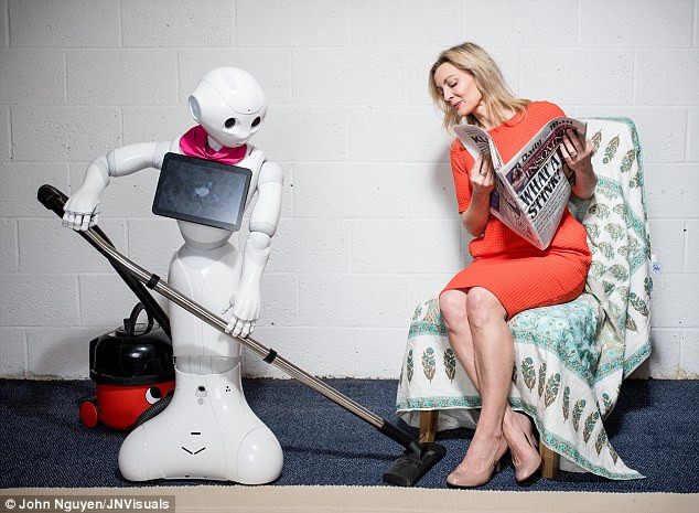 Robot cleans while woman reads.  Robots are now freeing up more time for humans to get creative and prepare for the Fourth Industrial Revolution.