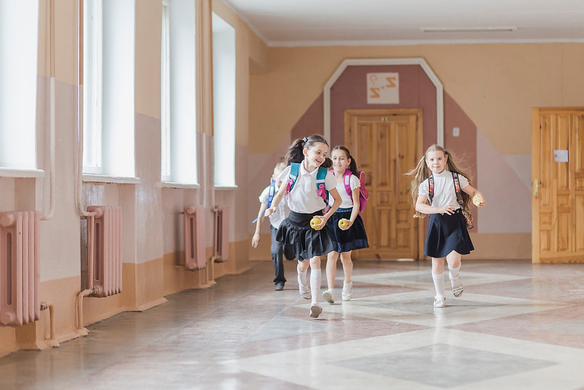 cheerful-kids-running-school-corridor_ed
