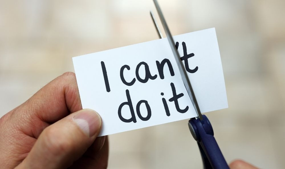 "a sign saying ""I can"""