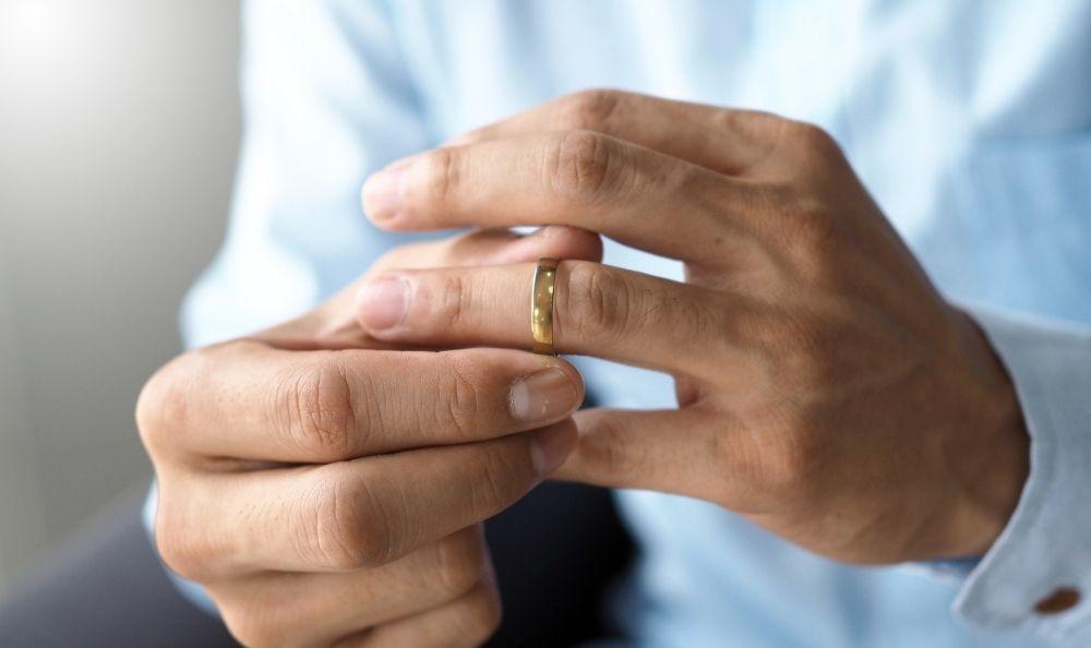 Man removing wedding ring