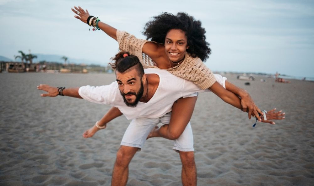 a young couple having fun on the beach