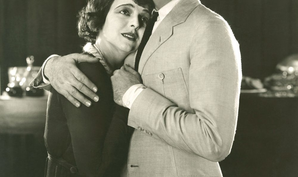old black and white picture of a woman crying on a mans shoulder