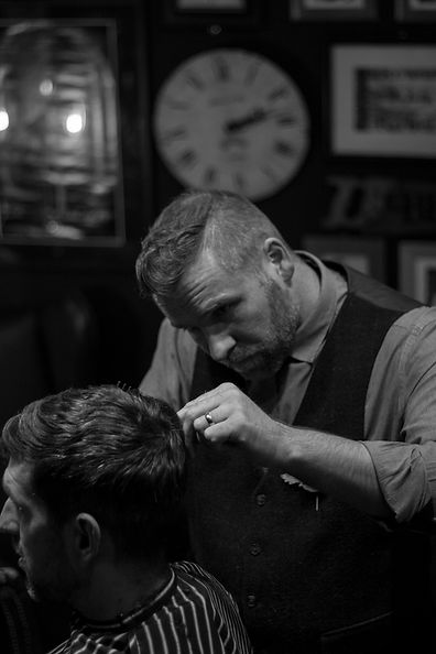 Jones The Barber cutting hair.