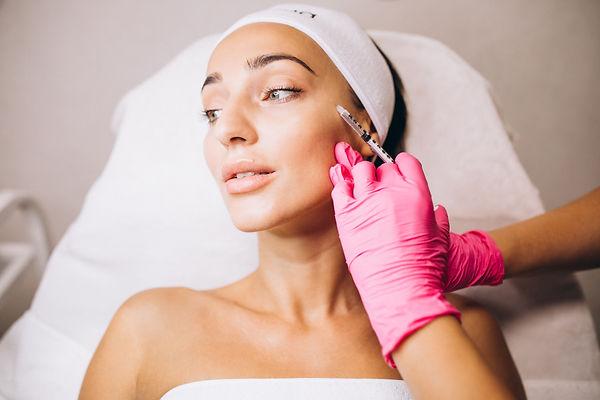 cosmetologist-making-injections-face-woman-beauty-salon.jpg