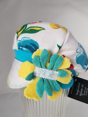 White with teal flower