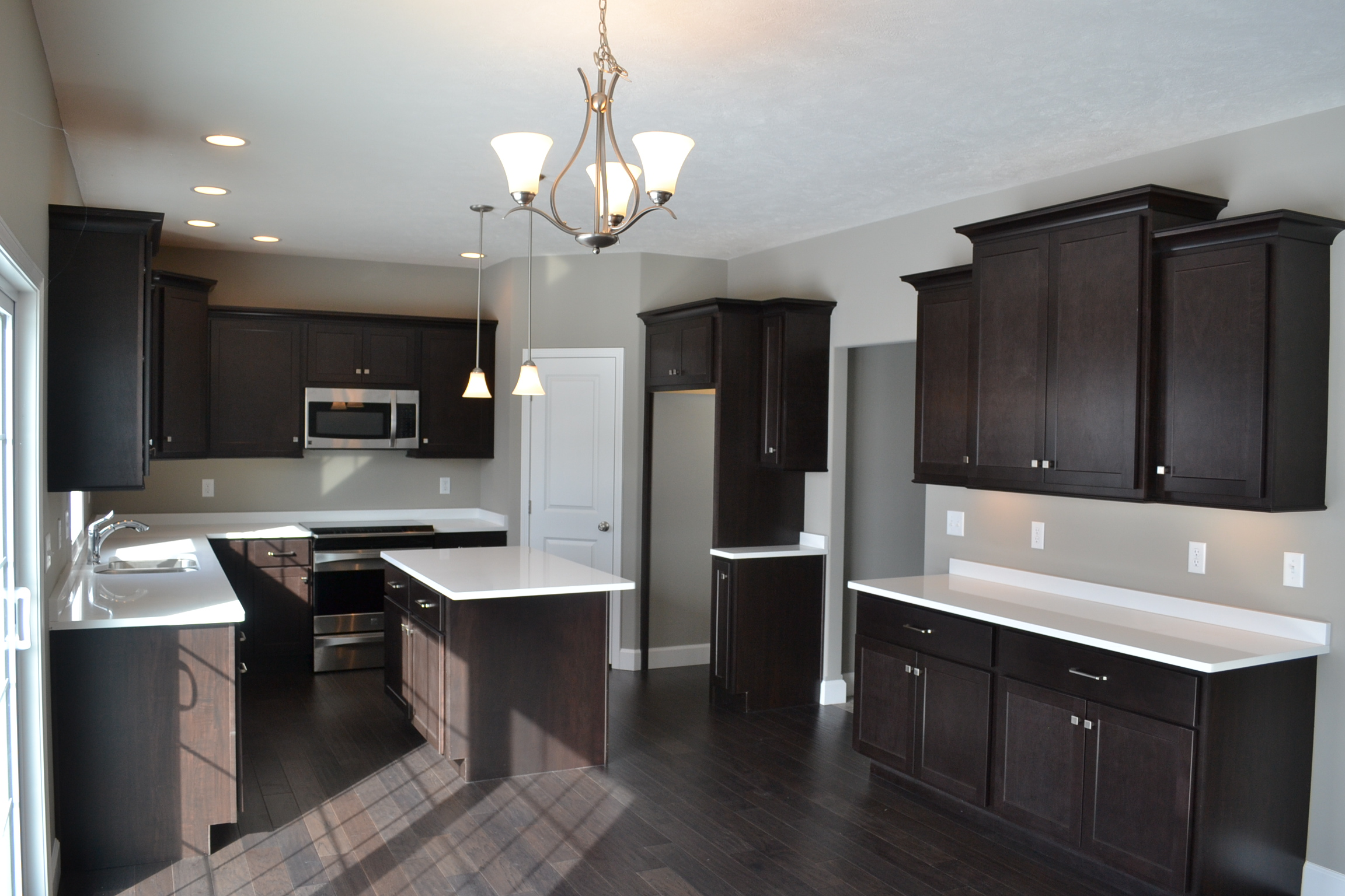 New Home in Champaign with dark wood cabinets