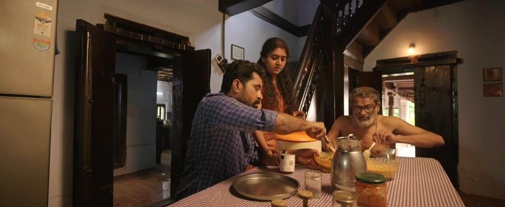 Patriarchy on screen: Suraj Venjaramoodu, Nimisha Sajayan, T Suresh Babu in a still from The Great Indian Kitchen. Image: Screengrab from Amazon Prime Video