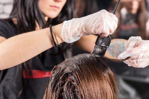 Hair Dresser Coloring Hair - Hall Benefits, LLC