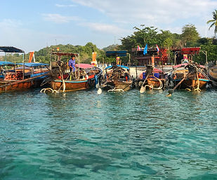 Long boats on the beach at Phi Phi Islands, Thailand