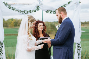 Elayna and Bryan exchanging wedding rings at their ceremony. Taken at the Timber Pointe Golf Club in Poplar Grove, Illinois.