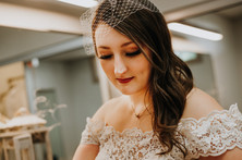 Leanna putting on her birdcage veil before the ceremony. Taken at the Randall Oaks Golf Club In West Dundee, Illinois.