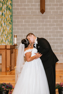 Ed and Kathryn's first kiss as husband and wife. Taken at St James the Apostle Catholic Church in Glen Ellyn, Illinois.