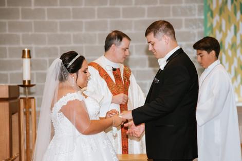 Exchanging rings. Taken at St James the Apostle Catholic Church in Glen Ellyn, Illinois.