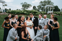 The bride and groom with their wedding party. Taken at Arrowhead Golf Club in Wheaton, Illinois.
