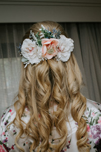 Elayna's bridal hairstyle and floral hair accessory.