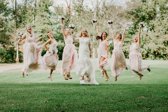 Jumping photograph of the bride, Elayna, and her bridesmaids. Taken at the Timber Pointe Golf Club in Poplar Grove, Illinois.