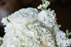 The wedding rings and the bridal bouquet. Taken at the Chicago Marriott Naperville.