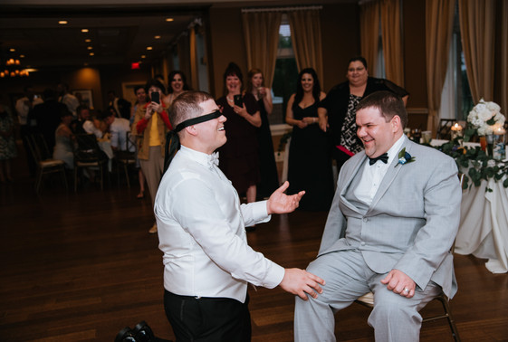 The groom getting tricked during the garter toss at the Pattara reception. Taken at the Arrowhead Golf Club in Wheaton, Illinois.