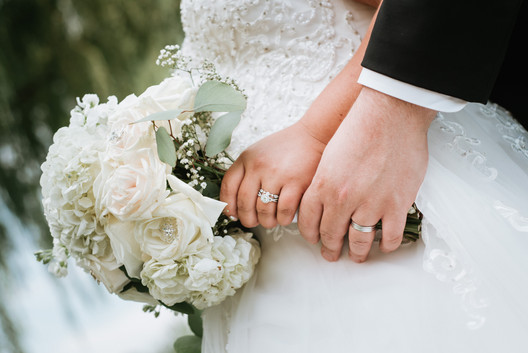 Detail photograph of the wedding rings and bridal bouquet. Taken at Arrowhead Golf Club in Wheaton, Illinois.