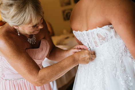 The bride getting into her dress. Taken at the Chicago Marriott Naperville.