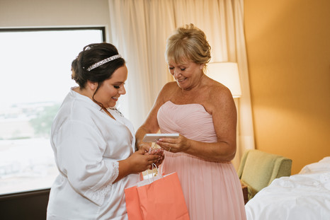 The mother of the bride receiving her wedding gift. Taken at the Chicago Marriott Naperville.