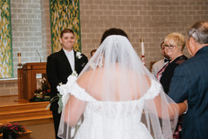 Ed getting his first look at Kathryn while she walks down the aisle. Taken at St James the Apostle Catholic Church in Glen Ellyn, Illinois.
