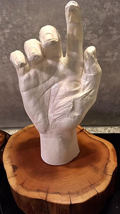 Freestanding hand cast in memory of loved ones on wooden plinth