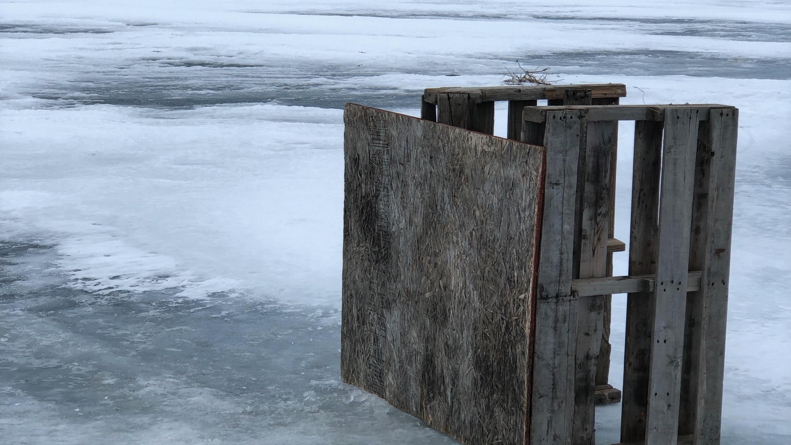 An ice fishing hole on the Kobuk River