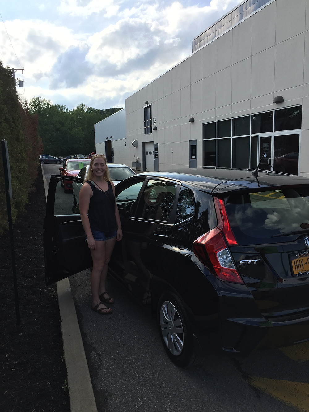 With my new car! It's a Honda Fit