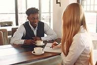 two-people-having-coffee-while-talking.j