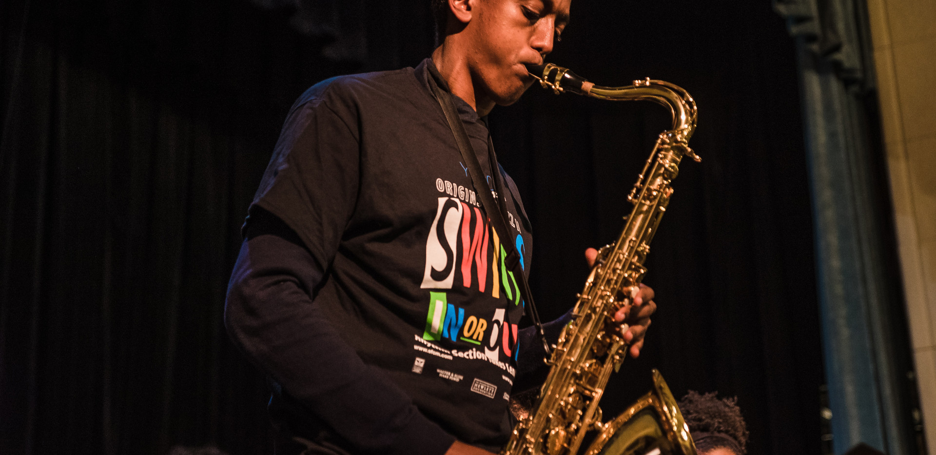 Paulos Thomas later performed on the tenor saxophone during the Jazz Big Band performance.