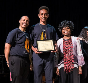 YMCO Senior Paulos Thomas accepting his award