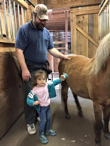 Image of 4H Club volunteer dad and daughter at H3-HopeHorsesNHeroes, Monroe WA