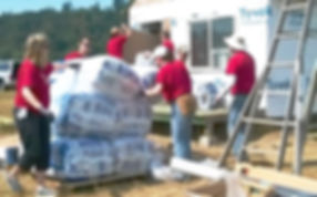 Image of volunteers help build and insulate temporary cabins at H3-HopeHorsesNHeroes, Monroe WA