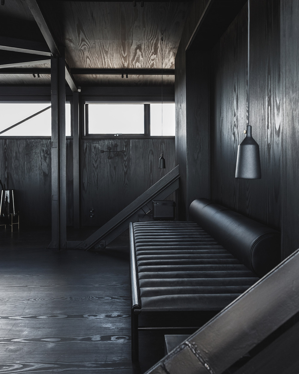 The intimate one-room hotel at THEKRANE is one of the most unconventional and exclusive hotel experiences that Copenhagen has to offer. The room at the top of the crane, in the old engine room, has a modern, minimalist decor with beautiful and functional furniture of the best Danish design. The all black furniture and the black-painted wooden walls and wooden floors create a sense of intimacy and calm.