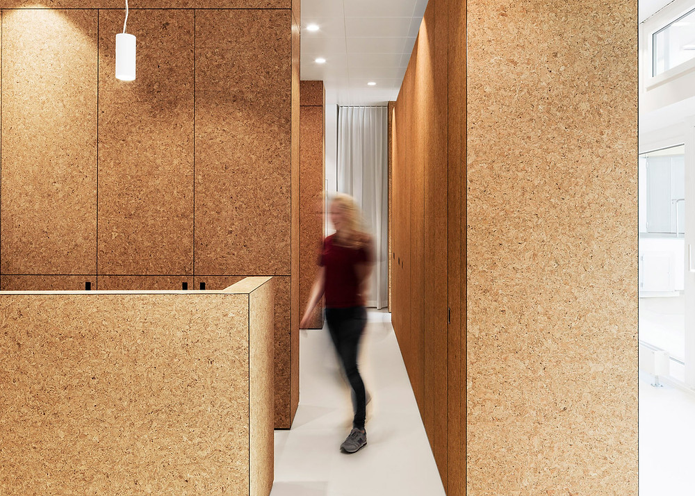 """Natural cork provides for a comfortable sound reverberation, regulates humidity and absorbs odours,"" said the architects. ""The resulting spaces embody the main values of the clients – care and tranquility."""