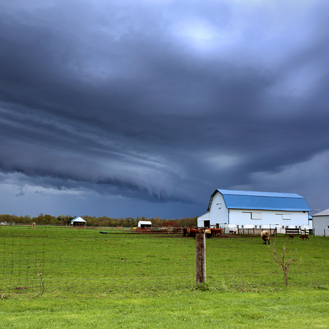 Farm and Storm Clouds