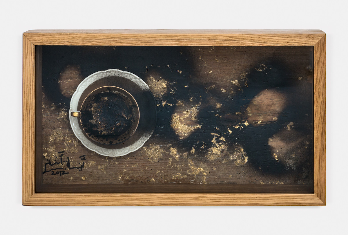 Gold Coffee 1, 2012, Readymade (Gilt cup and saucer), Gold leaves and Tar on Plywood, 30X50X15 cm.