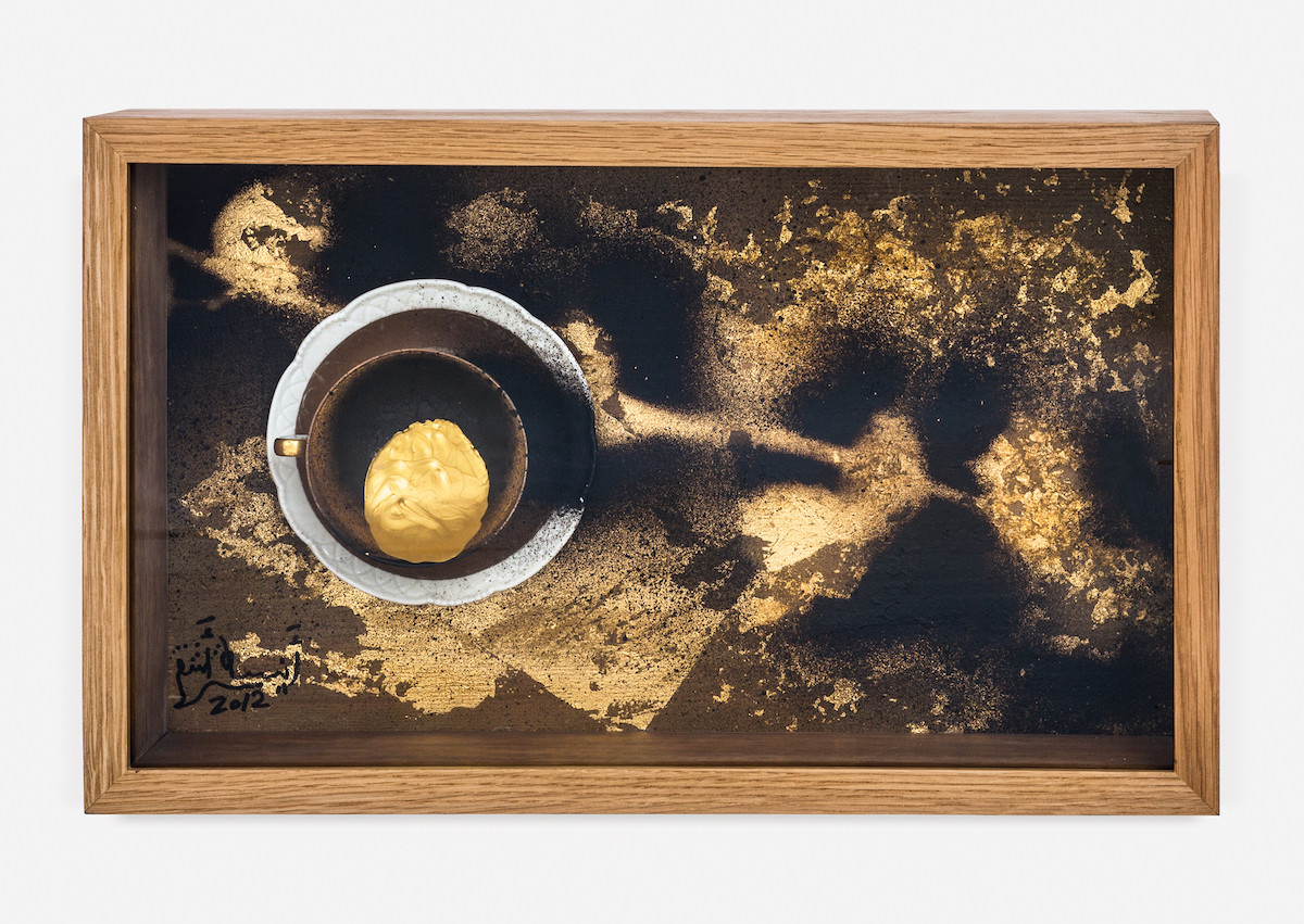 Gold Coffee 2, 2012, Readymade (Gilt cup and saucer), Gold leaves and Tar on Plywood, 30X50X15 cm.