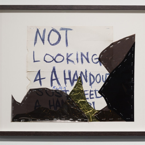 John Knuth, Not Looking 4 A Handout…2019, Homeless sign, mylar, staples, Framed with UV protective plexiglass, 16 x 20 in