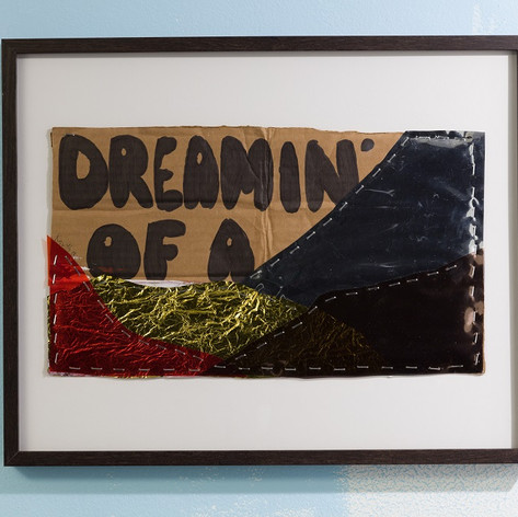John Knuth, Dreamin' of a..,  2018,  Mylar, homeless sign, and staples, 16 x 20 inches, Framed with UV protective plexiglass