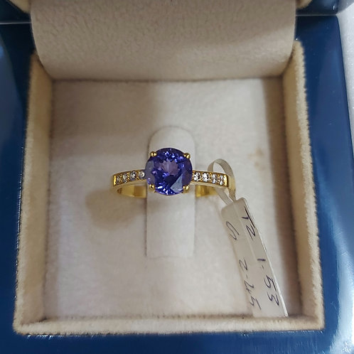 Yellowgold ring with tanzanite and zircons