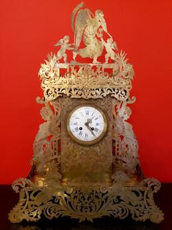 Pendule en cuivre découpé XIXe siècle