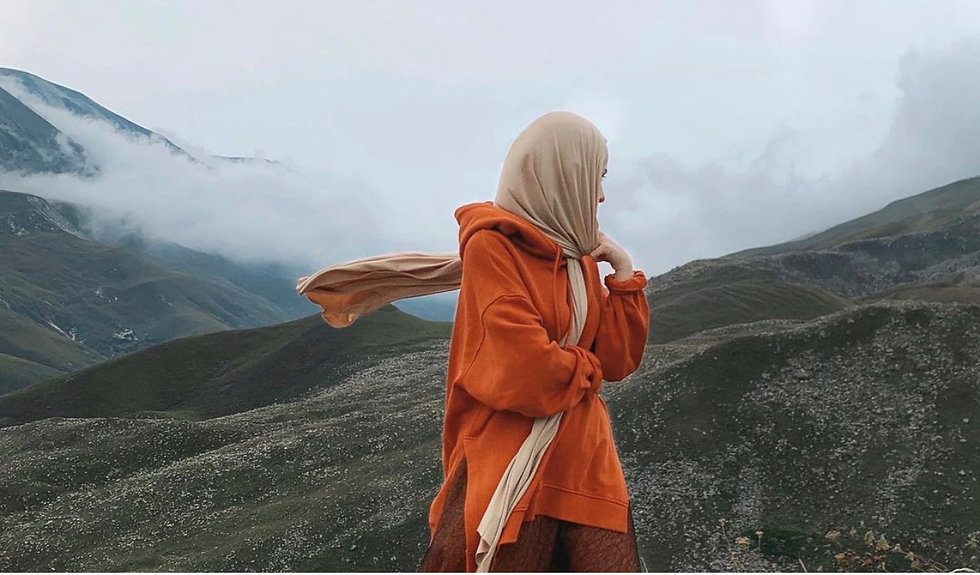 Hijabi in the mountains, in orange sweat