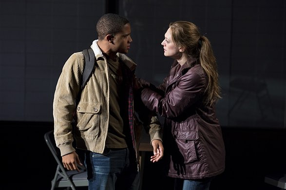 B (Nicholas L. Ashe) and Andy (Marin Ireland) outside his school.
