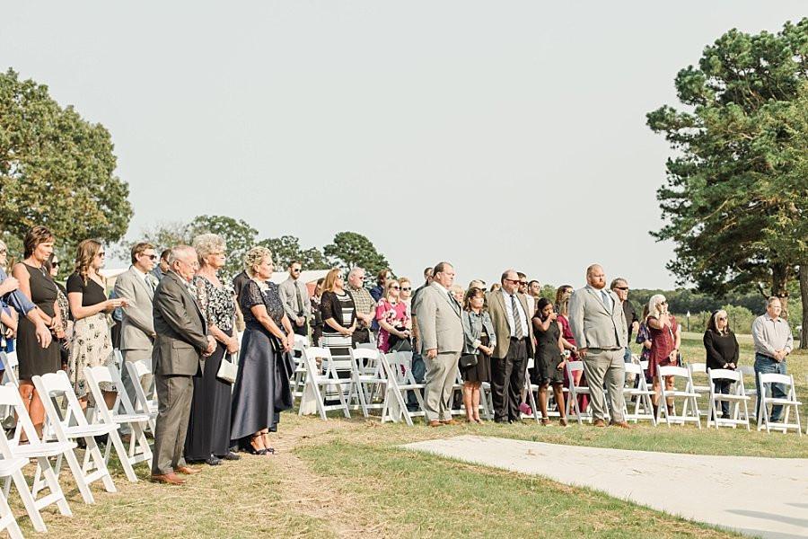 wedding guest attending outdoor wedding in Owensville Mo