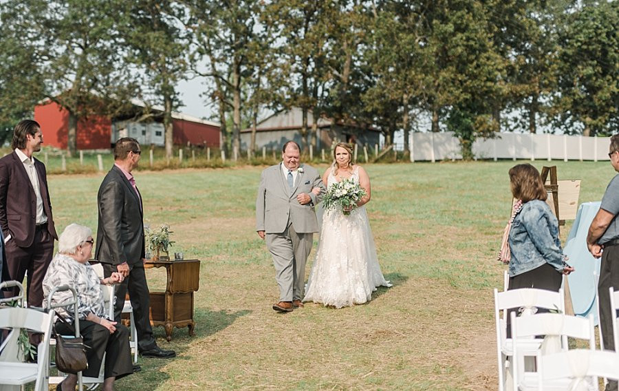 bride and dad walking down the aisle at Red Oak Valley lakeside wedding ceremony