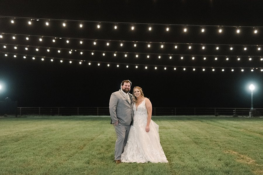 bride4 and groom celebrating at night on Red Oak Valley Patio
