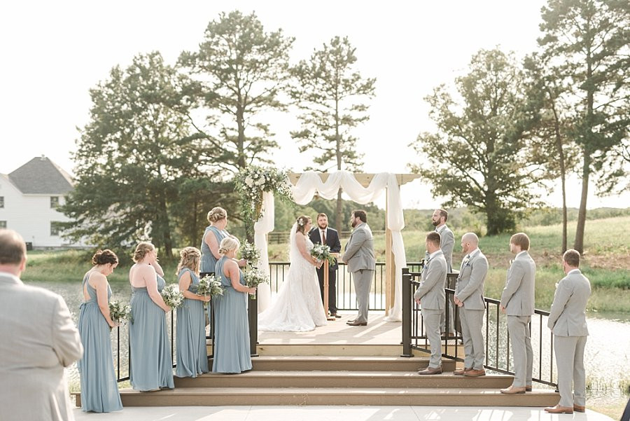 Bride and Groom exchange vows in lakeside ceremony at Red Oak Valley wedding