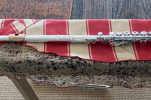 Flute Mat, silk sari, light reds and black swirls